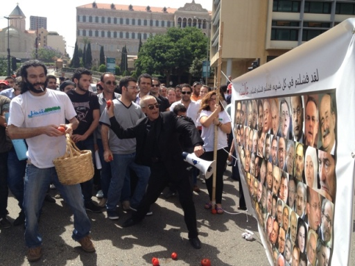 A handful of protesters take to the streets on May 31, 2013 protesting the Lebanese parliament's extension of its term. Protesters threw tomatoes at a canvas of the 128 MPs. Picture by http://www.beirutreport.com/ - Habib Battah