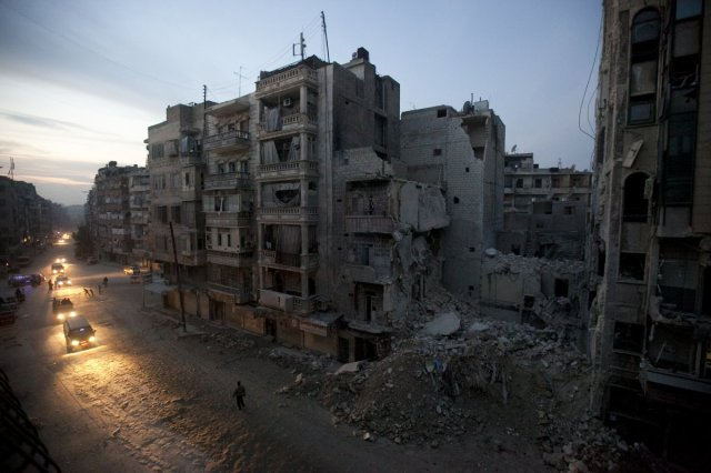 "Business Insider's ""The 20 Award-Winning Photos From The War In Syria Everyone Should See."" Night falls on a Syrian rebel-controlled area of Aleppo, Nov. 29, 2012, as destroyed buildings, including Dar Al-Shifa hospital, are seen on Sa'ar street after airstrikes targeted the area a week before.  Source: AP Photo/Narciso Contreras."