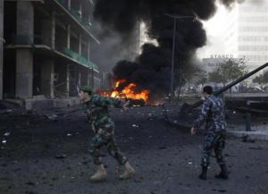 Lebanese army soldier gestures as he runs near the site of the explosion in Beirut's downtown area